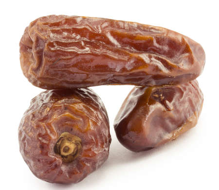 still-life dates, dried fruit on a white background photo
