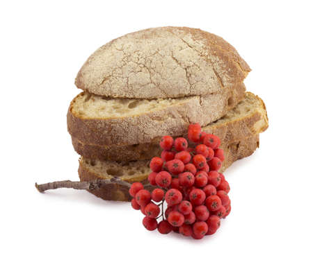 slices of bread and red berries of mountain ash photo