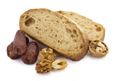 still life sliced ​​bread, dates and nuts on a white background photo