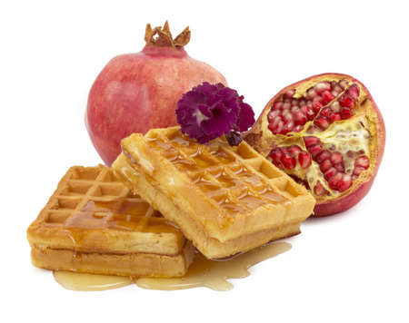 pomegranate, violet, waffle on a white background photo