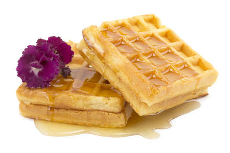 waffle, honey, violet on a white background photo