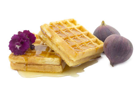 figs, waffle on a white background photo