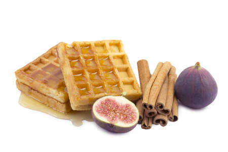 waffle, figs, cinnamon on a white background photo