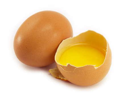 two eggs, one broken egg, egg yolk Banque d'images