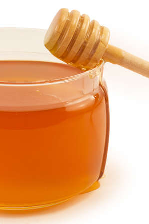 sweet, delicious honey in glass jar photo
