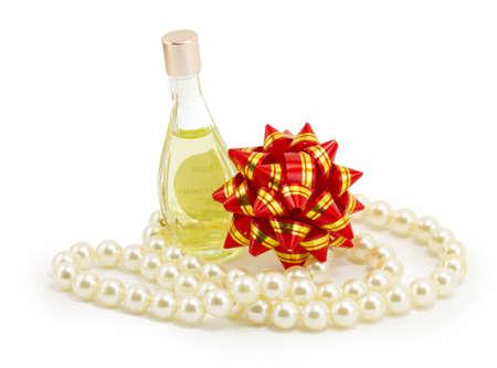 christmas perfume: perfume, pearls, bow isolated on white background Stock Photo
