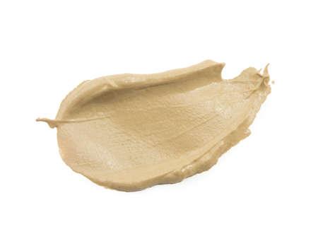 Abstrich Farbe oder Creme auf weißem Hintergrund