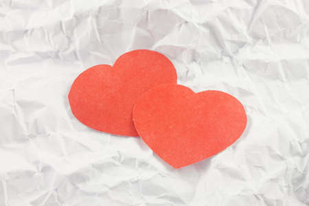 red heart on a background white crumpled office paper Stock Photo - 17408280