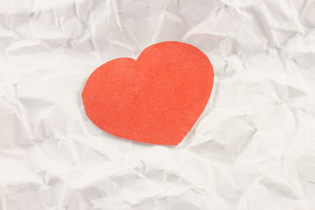 red heart on a background white crumpled office paper Stock Photo - 17408275