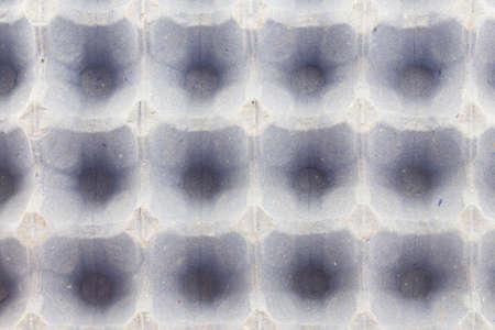 blank gray tray of eggs photo