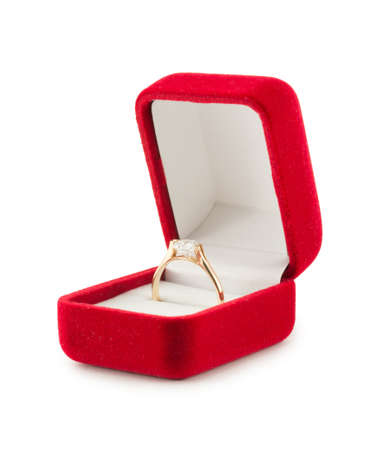 gold wedding ring in a red gift box