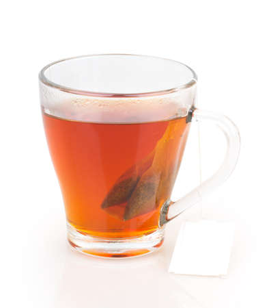 cup of tea with tea bag isolated on white background