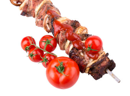 Isolated roasted meat on the metal skewer photo