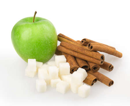 apple, sugar cubes, cinnamon isolated on white background photo