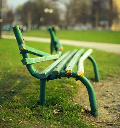 broken green bench in the park