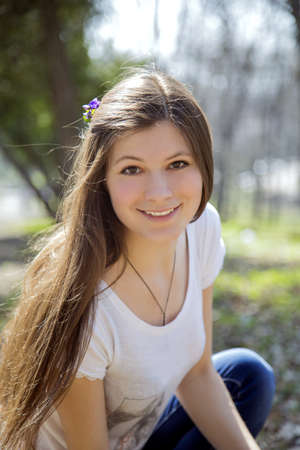 portrait of a happy young woman smiling photo
