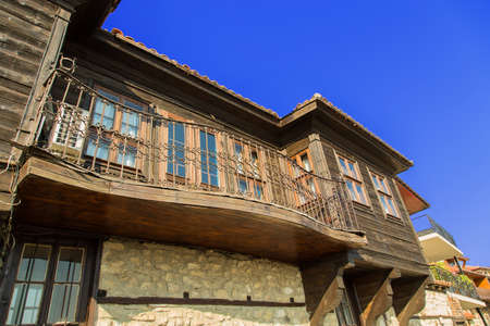 wooden building with balcony photo
