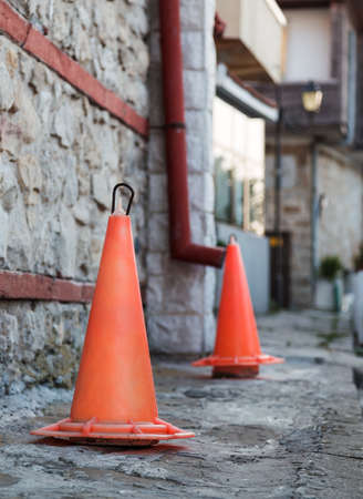 traffic cone stone wall  photo