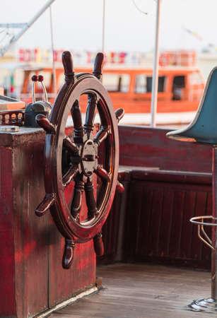 ship wheel brown shiny wood photo