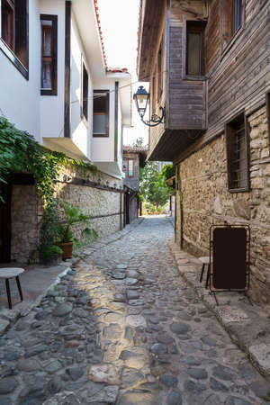 historically narrow street with stone houses photo