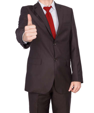 confirms: thumb up male businessman confirms approves Stock Photo