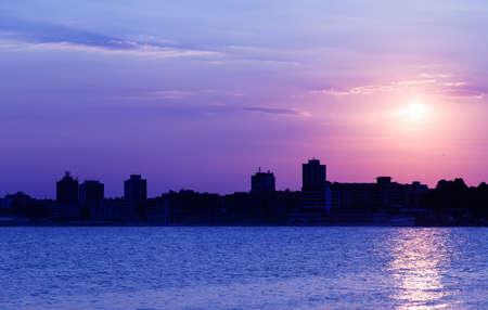 Sea sunset city sky cloud photo