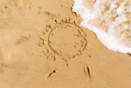 sun drawing in the sand photo