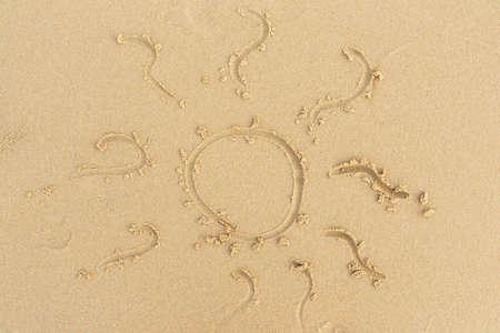 sand drawing: beach sand sea sun sign Stock Photo