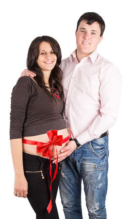 bow belly: pregnant wife, a woman with her husband isolated on white background