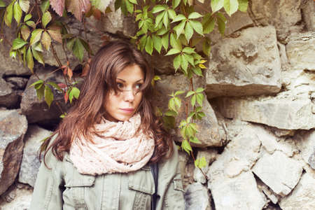 portrait woman outside background stone wall photo