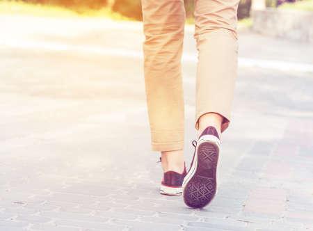 woman sunny walk legs gumshoes photo