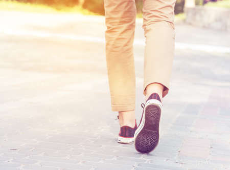 woman sunny walk legs gumshoes photo