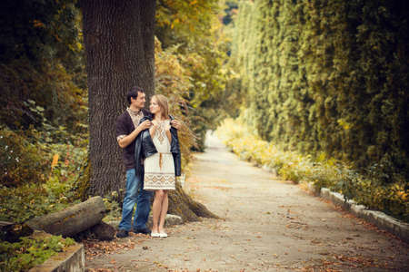 Young couple in love walking in the autumn park photo