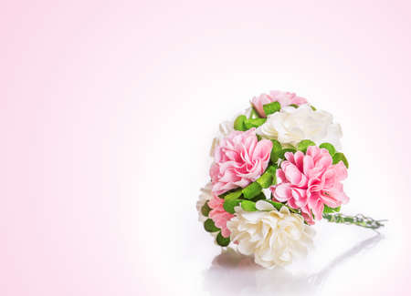 artificials flowers on a pink background photo
