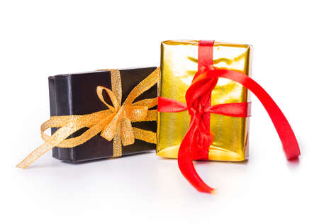 Two gift box bow red yellow black Isolated on white background photo