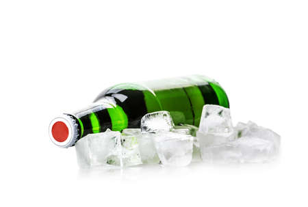 beer bottle in ice cubes isolated on white background photo