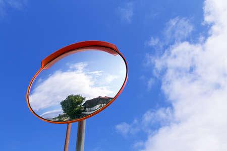convex: road convex mirror against the sky