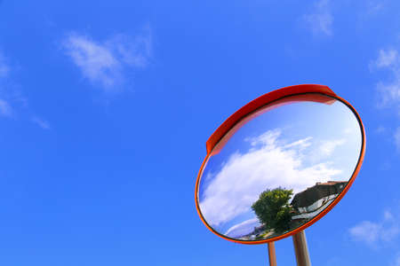 convex: road convex mirror against the sky