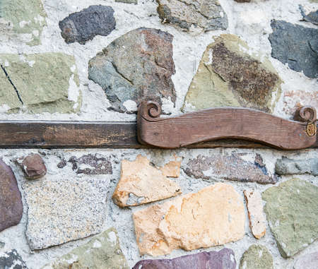 plaque: wooden plaque on the stone wall Stock Photo
