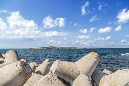 breakwaters: breakwaters on the shore blue sea