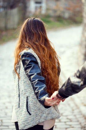follow: couple follow me holding hands Stock Photo