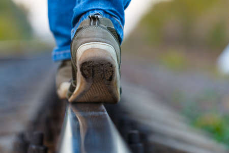 rails: railroad rails feet sneakers jeans