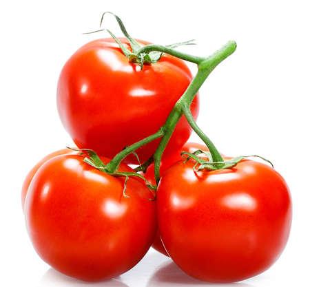 jitomates: Tomates aislados en el fondo blanco Foto de archivo