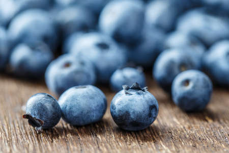 berry blueberries on a wooden background