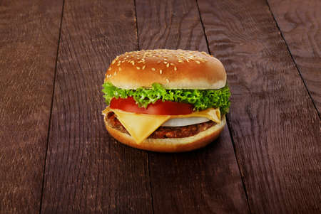 appetizing burger on a wooden board