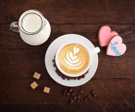 white cup coffee sugar grains carafe of milk on a wooden board Stok Fotoğraf