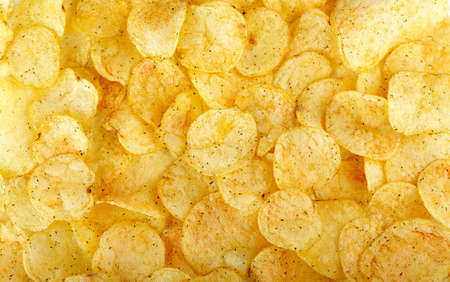 appetizing yellow potato chips background fast food