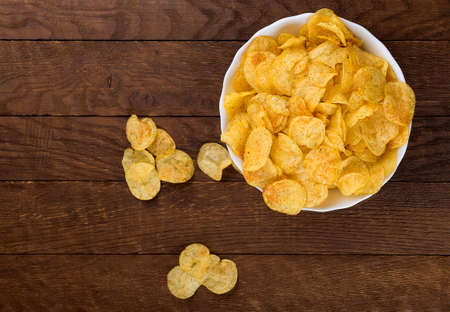 potato chips on wooden background fast food