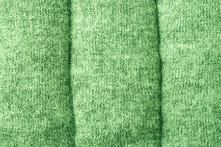 quilted: Quilted jersey fabric texture.