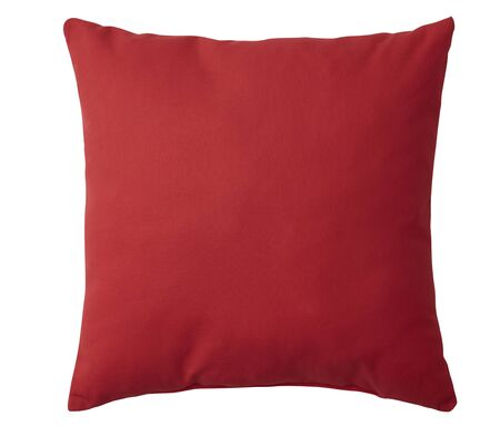 Red pillow isolated on white background.